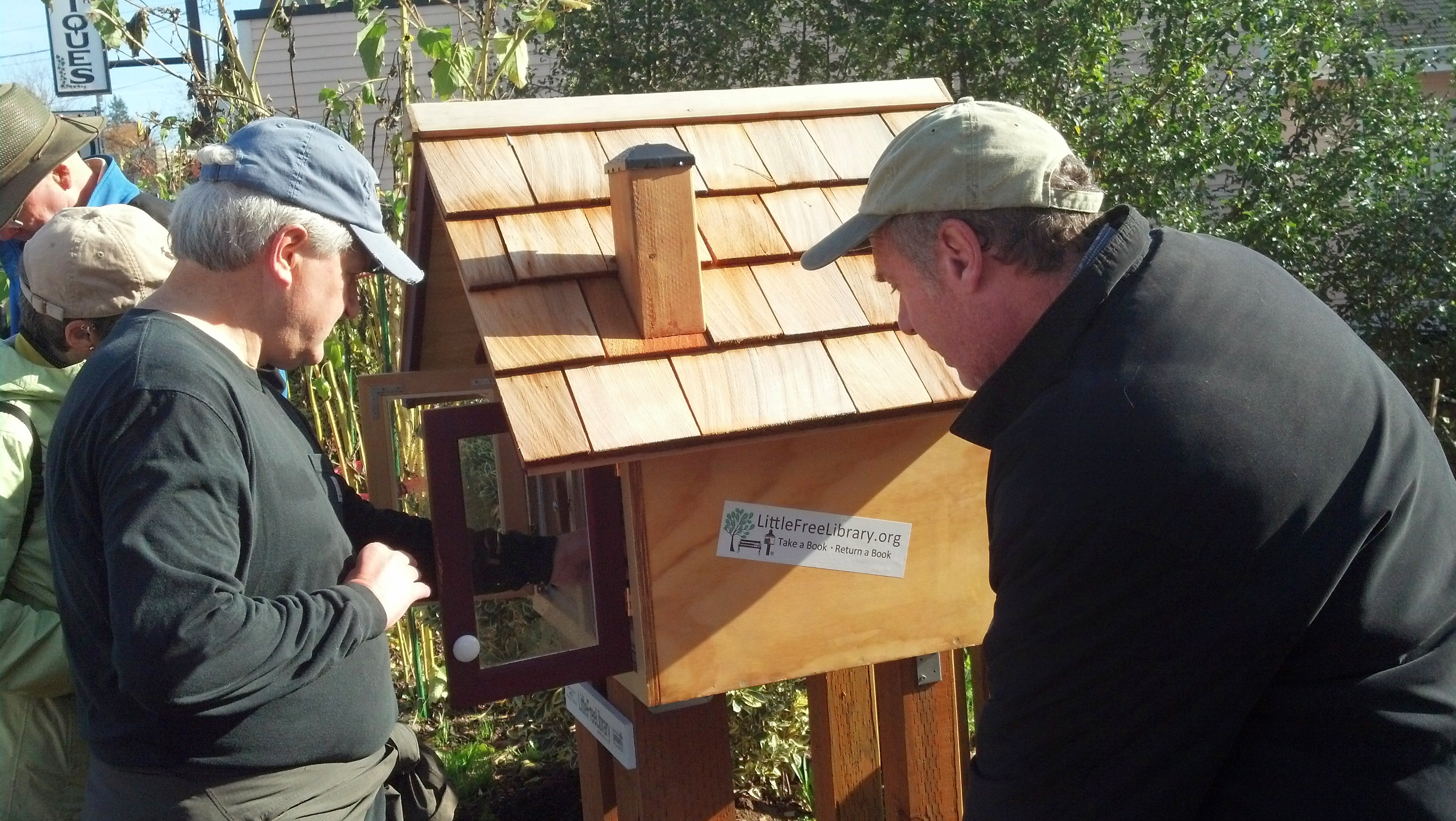Little Free Library in front of Neighborhood House in the center of Multnomah Village.
