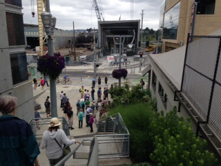 After crossing the Gibbs Street pedestrian bridge over the I5 freeway, the walkers descended the stairs to the base of the Portland Aerial Tram.