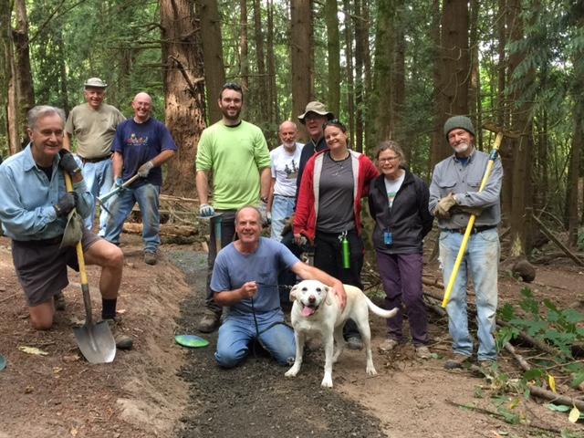 Trail building crew plus dog