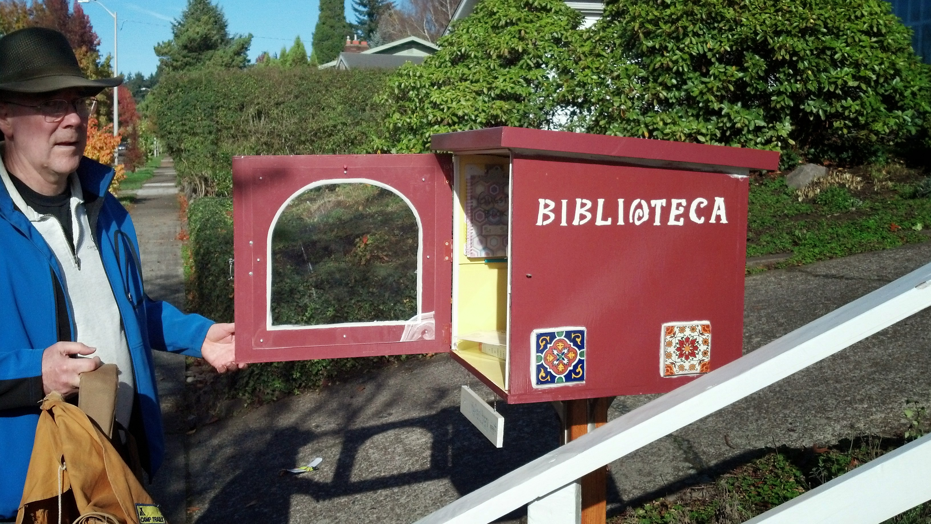 Biblioteca - a Little Free Library on SW 15th between SW Vermont and SW Chestnut.